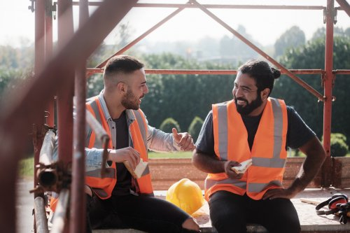 two construction workers chatting on their lunch break