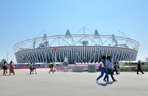 People Walking Past Olympic Stadium