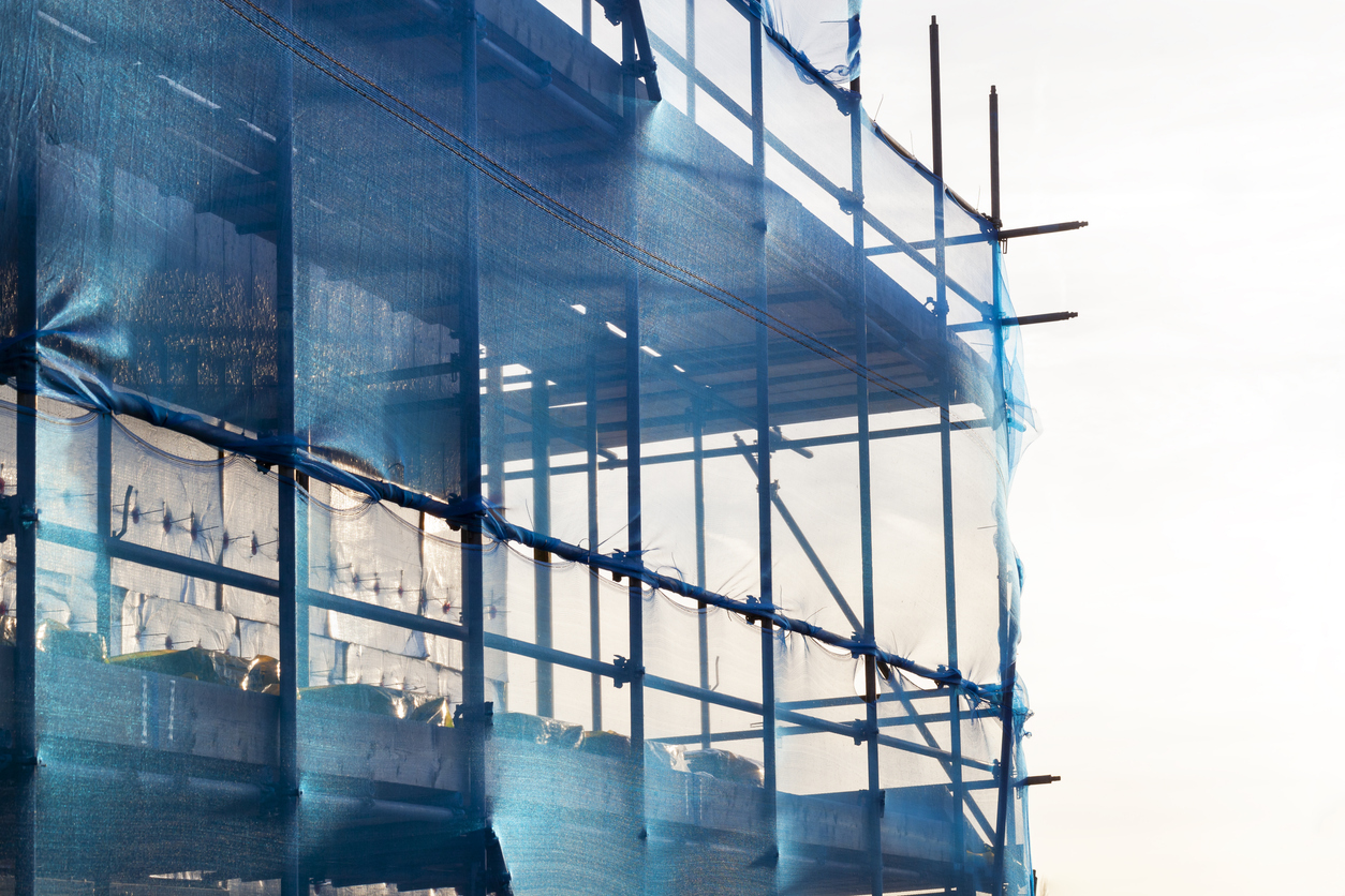 Blue scaffolding with safety netting